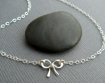 tiny silver bow necklace. very petite sterling silver ribbon pendant bowtie small mini simple delicate dainty forget me knot charm gift 3/8""