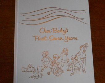 Vintage baby book Our babies first seven years