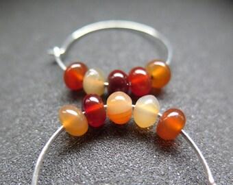 orange carnelian earrings. natural stone jewelry. hammered sterling silver hoops.