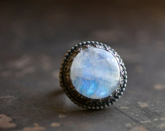 full moon, a round moonstone ring in antiqued dark sterling silver, with bead and pattern bezel detail, size 6.5