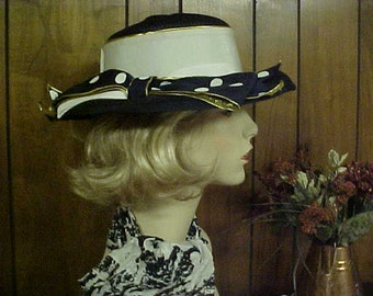 Wide brim navy blue straw hat with polka Dot bow- designer label- fits 22-23 ""