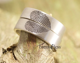 Unique Set of fingerprint wedding bands that create a heart exclusive to Brent&Jess Handcrafted in Sterling Silver