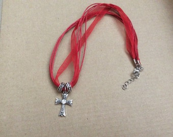 Red organza ribbon necklace with cross pendant