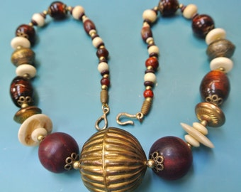 Large vintage 1960 BOHO TRIBAL ETNIC handcrafted natural organic bone/ wood/ brass/ glass necklace with x-large brass centerpiece bead