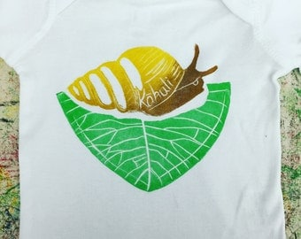 Baby Onesie, White, with Green, Yellow, and Brown Kahuli (Endangered Native Hawaiian Tree Snail) block print