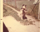 German Shepard Dog With Big Bone in His Mouth Back Yard 1970s Vintage Color Photo Photograph