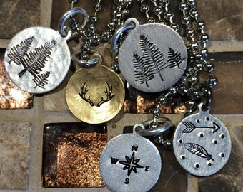 Hand stamped dainty necklaces. Trees antlers arrows feathers compass