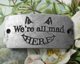 NEW We're All Mad Here!  Mad Hatter Cheshire Cat Alice In Wonderland Stamped Wrist Pendant