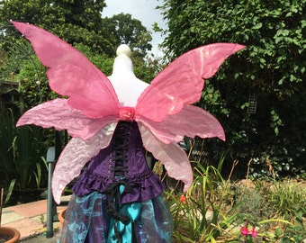 Triple adult pink fantasy fairy wings.