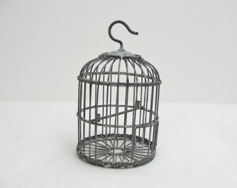 Small metal birdcage ready to decorate