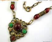 40% Off Vintage 1920s Art Deco Necklace Czech Brass Cabochons Rust Red and Green