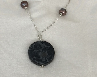 Circle on circle pendant on sterling silver with pearls