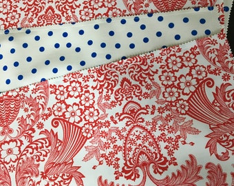 red, white and blue reversible oilcloth placemats