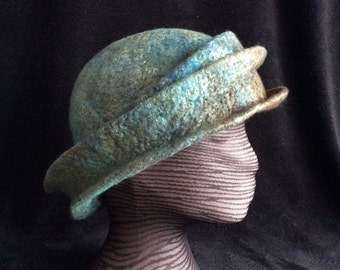 A wet felted merino wool and silk sliver triple brimmed fall and winter hat