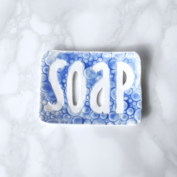TYPO soap dish with cobalt blue bubble texture, white porcelain recessed letters bathroom accessory