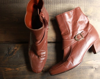 Tan ankle boots by Selby US 6M