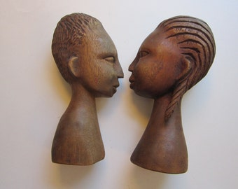 2 vintage carved heads - man and woman