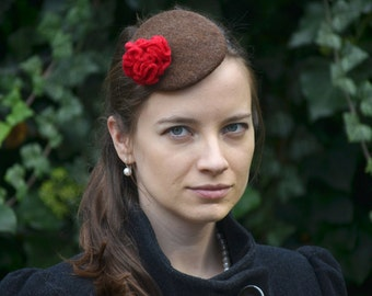 Brown baret with red flower