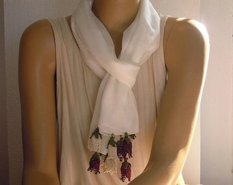 white cotton scarf with purple and white crochet tulips