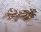 Vintage Silver Tone Clear Faceted Rhinestone Flower Brooch with Curled Stems