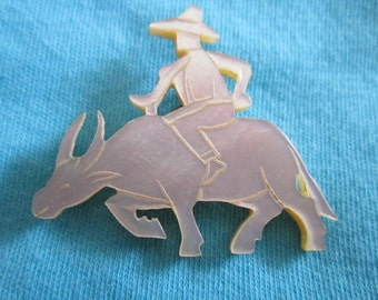 Vintage White Shell Brooch of Rider on Asian Ox