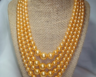 1972 Multi Strand Orange Peach Colored Faux Pearls.