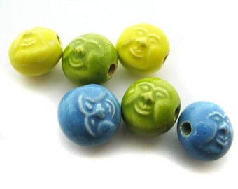 10 Tiny face Beads -