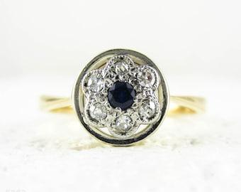 Vintage Sapphire & Diamond Daisy Ring, Blue Sapphire with Diamond Halo in Circle Shape Frame. Circa 1930s, 18ct and Platinum.