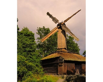 Fine Art Color Photography of a Windmill and Dramatic Sky in Sweden