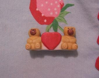 very tiny bears and heart figurine
