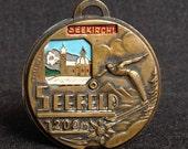 Austria travel souvenir pendant. Vintage Alpine medal from Seefeld.