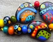 Dixie Dots - Handmade Lampwork Bead Set (13) by Anne Schelling, SRA