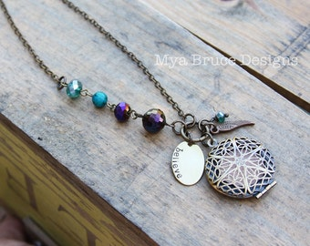 DIFFUSER necklace -  long antiqued gold design with Aurora Borealis  shades, angel wing and hand stamped oval