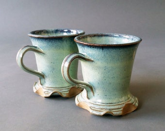 His and Hers Set of 2 Footed Skirted Mugs Greens Speckled Blue