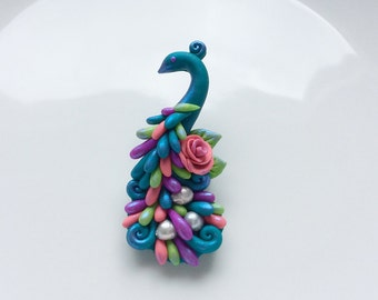 Peacock brooch pin handmade from polymer clay in turquoise, pink and green