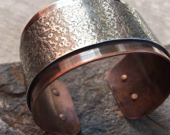 wide copper and pewter cuff with a cherry blossom texture