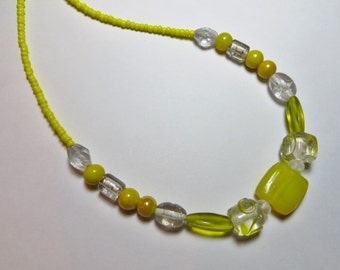 Yellow and clear glass beads one of a kind 20""