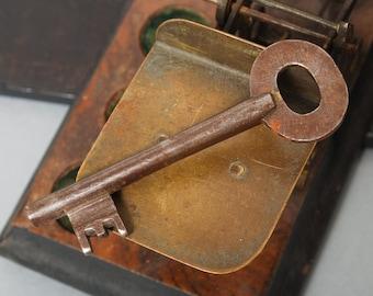Vintage rusty metal skeleton key. Old patina