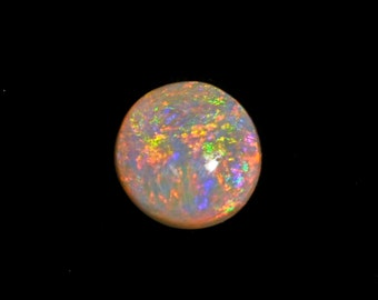 1.4 CT. lightning Ridge Semi Black Opal has potent flash fire.