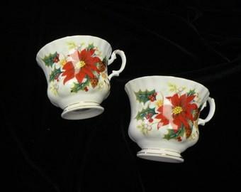 Two Royal Albert Bone china Poinsettia Pattern Tea cups