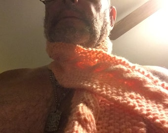 Hand knitted peach colored cabled scarf