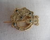 Vintage 1980s to 1990s Gold Tone Signed Sword and Shield Pin/Brooch Green Rhinestones Celtic