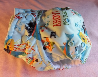 SassyCloth one size pocket diaper with pirate rascals PUL print. Ready to ship.