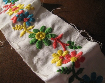 ONE yard of 3 inch wide fairy tale bright flower embroidered trim from 1960s