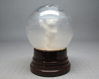 Vintage snow globe with waving polar bear , dry inside