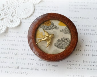 Wooden Brooch with Metal Bird on Cloud Background in Resin