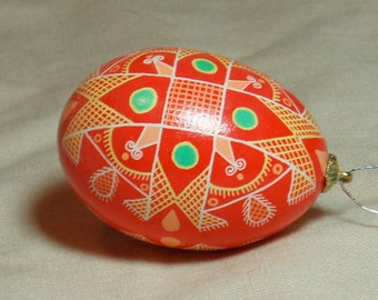 Red and orange netted cross pysanka, real chicken egg batik ornament for Easter, Christmas, or everyday ornamental display