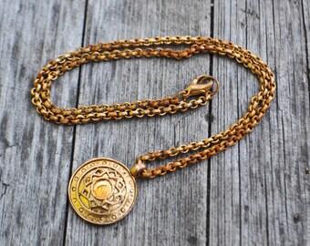 Vintage metal necklace pendant.