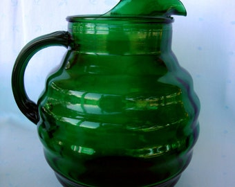 Vintage whirly twirly forest green glass pitcher Anchor Hocking emerald hunter dark green glass
