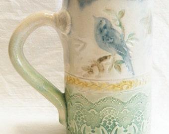 Ceramic blue bird on a branch coffee mug 16oz. stoneware 16B061